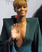 Rihanna's sweet ass in juicy cleavage in a sexy green pantsuit in this gallery
